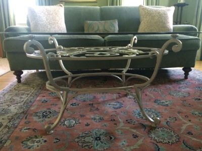 Beveled glass-top oval coffee table