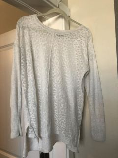 Cream colored light weight/thin longer sweater size L