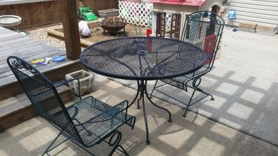 Metal patio table and 2 chairs