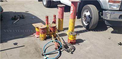 AIR JACKS WITH STANDS, SPACERS AND TWO PORTA PUMPS