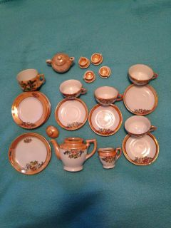1900's children's porcelain tea sets from Japan. Was my mom's when she was little.