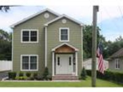 Three BR/2.One BA Property in East Norwich, NY