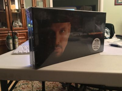 Brand new in the factory plastic garth brooks the limited box series sat with six desks one DVD +68 page booklet never been opened