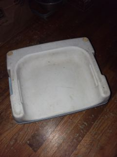 *2 sided booster seat. Needs a bath. One side sits child higher then other side