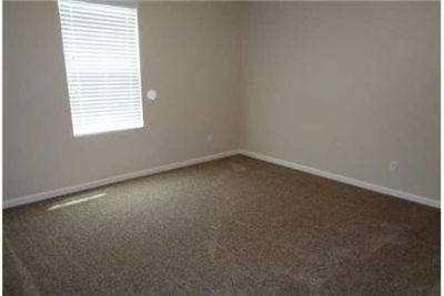 This 4 bedroom, 2 bath home has 3342 feet of living space. Dog OK!