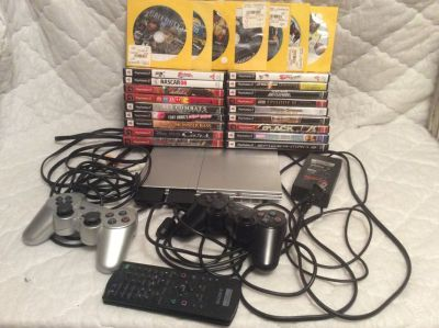Game: Sony PS2 Slim with 25 Games