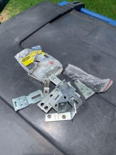 Miscellaneous hinges and corner braces. $1 takes all.