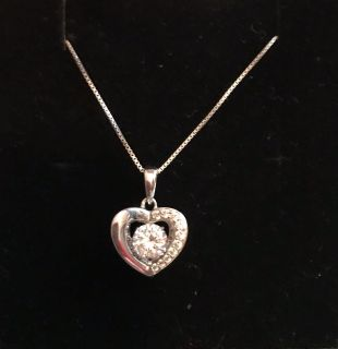 Floating heart pendant c/z with chain reg $100.00
