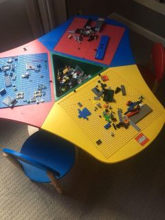 LEGO table with legos and 2 chairs