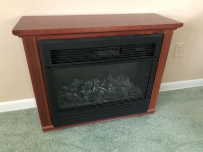 Amish Heat Source Fire Place. 32 x 11 x 25 . Photo of Manufacturing Plate Attached. Works Great & In Good Condition