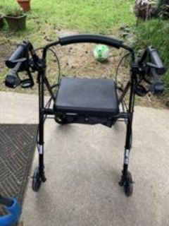 Drive walker with seat and wheels