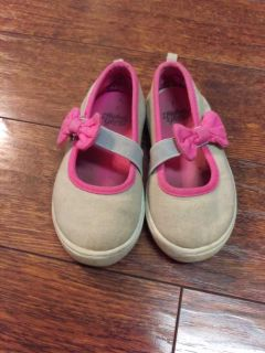 Tan and pink slip on shoes