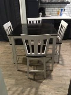 farmhouse style high top table with 4 chairs