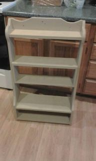 Shelf, stands 3 ft high by 22 wide. Needs paint. Could use in bath, utility room or whatever.