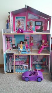 Wooden Barbie house, furniture, 13 barbies, Barbie car.