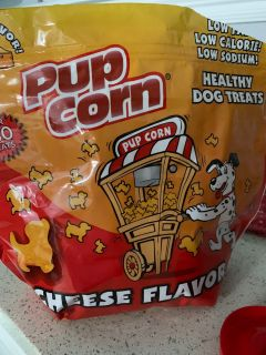 Half bag of pup corn! Dog treats! Opened bag but my doggie is sick of them of that s possible!