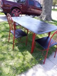 table and 4 chairs. wrought iron and wood