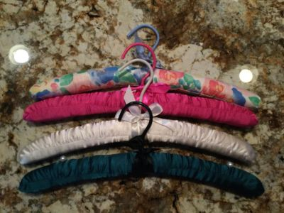 Lot of 4 satin covered, padded hangers