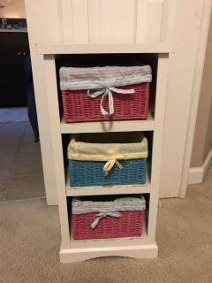 Storage shelf. About 2 feet tall. 3 baskets with liners. See description. Porch pickup.