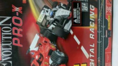 Slot car race track Formula 1 with high-end car used