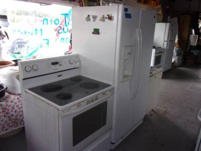 Maytag Water and Ice in Door Refrigerator and Glass Top Electric Stove