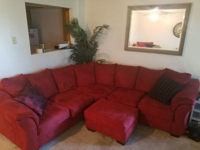 Red suede sectional couch w/ chair & ottoman