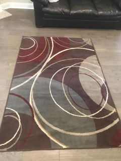 Area rug - 5 feet by 7 1/2 feet excellent condition
