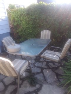 Patio table, chairs, umbrella stand