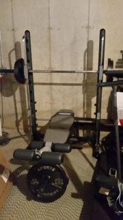 Half smith weight machine with bench with weights- several hook in safety stops