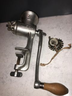 Vintage Universal meat grinder with extra blades. Excellent condition
