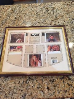 Collage frame brand new never used holds eight pictures