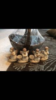 Angel candleholders with basket
