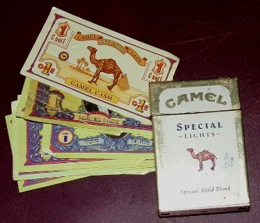 Old used Camel lighter and Camel Dollars