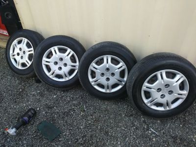 4 Factory Rims with 1 month old tires 285/70/14