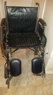 New wheelchair with leg rests $80