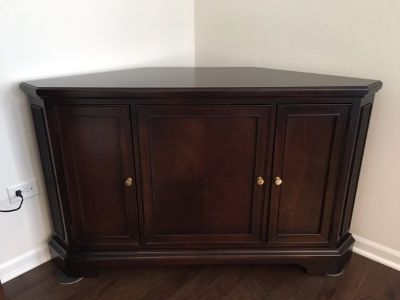 REDUCED PRICE !!!!! Classic solid Wood, Walter E. Smithe Corner Cabinet with power strip