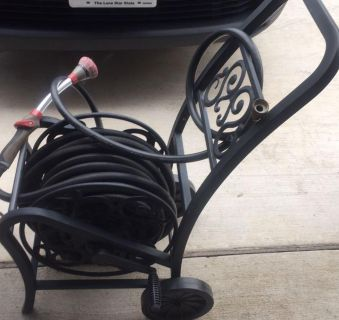 Two 50 foot contractor grade garden hoses connected to a metal decorative hose reel on wheels. $75 for complete set.