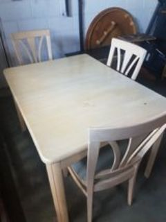 solid table and 3 chairs