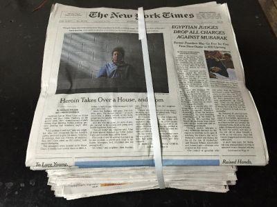 Bundled over issue newspaper