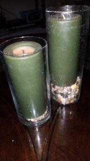 Pair of candles in glass with stones in bottom
