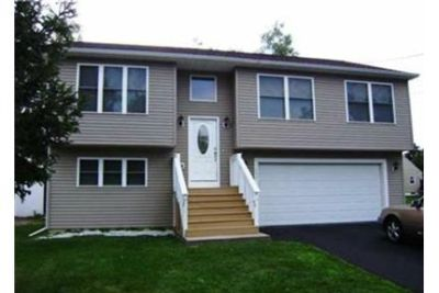Fabulous 3 bedroom 2 and a half bath raised ranch. 2 Car Garage!