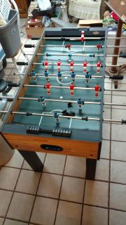 Foosball table. Perfect working condition. Full size. No chips or dents.