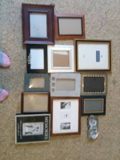 13 picture frames, 1 memeory book holds 64 pics