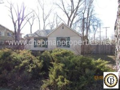 North end 2 bedroom 1 bath house with wood floors and patio!