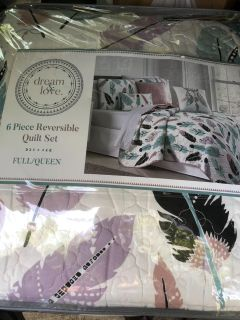 New never used six piece reversible quilt set
