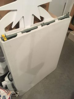 Folding table, 6-foot long x 30 wide when unfolded. Has a carrying handle. Great for tailgating, camping & garage sales.