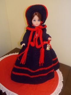 Caroler in Hand knitted outfit
