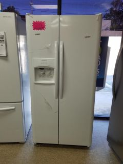 Frigidaire white side by side refrigerator never used