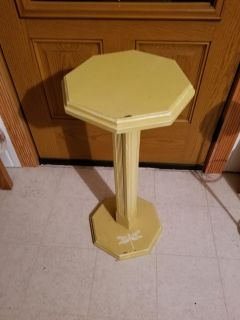 Pretty yellow table with dragon fly painted on the base