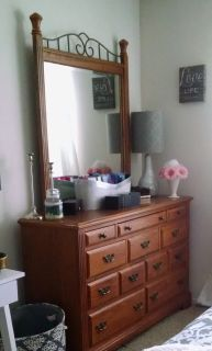 Broyhill oak 10-drawer dresser with mirror; top three drawer are lined